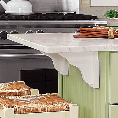 farmhouse kitchen with decorative carved wood supports