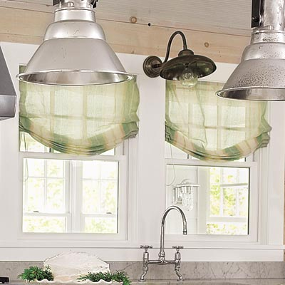 farmhouse kitchen with green light diffusing shades