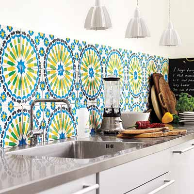 kitchen with colorful tile backsplash medalions