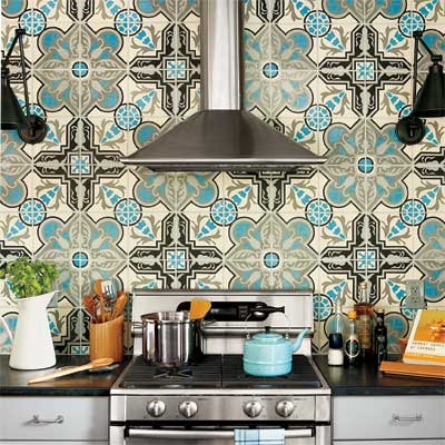 vent hood with two wall sconces and bright patterned wall paper