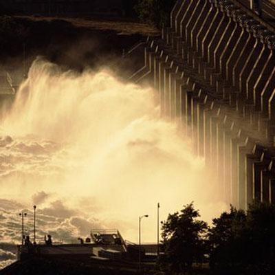 raging water against dam