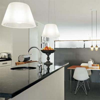 two styles of pendant lights hanging in an open design modern kitchen