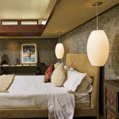 pendant lanterns hanging on either side of a headboard