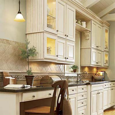 pendant hung beside a bank of upper cabinets illuminating the countertop beneath