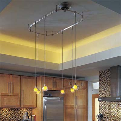multiple pendant lights on an oval track fixture