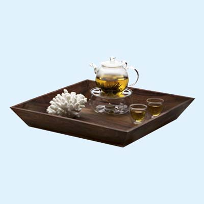 glass tea pot and cups on rosewood serving tray