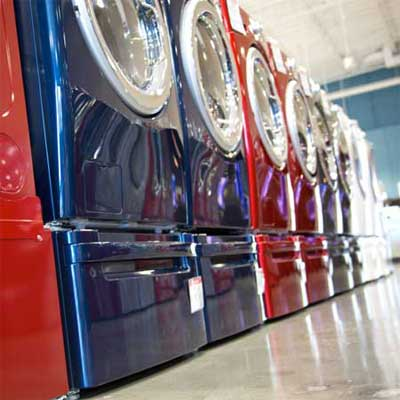 long row of shiny and brightly colored washer dryers