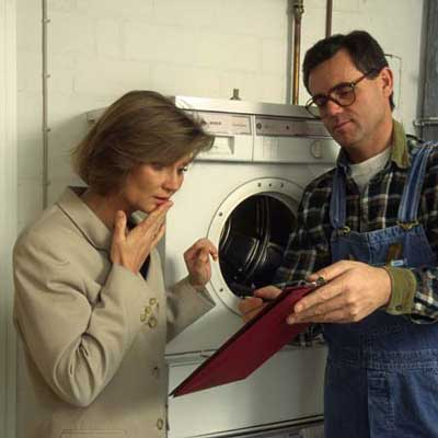 appliance repair person showing an estimate to a home owner
