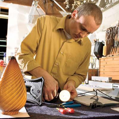eric kaster making lighting fixture in workshop