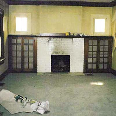 the living room and fireplace before the remodel