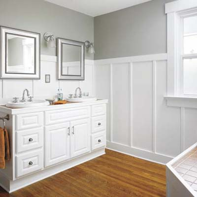a newly installed master bath with a spa tub and a his-and-hers vanity