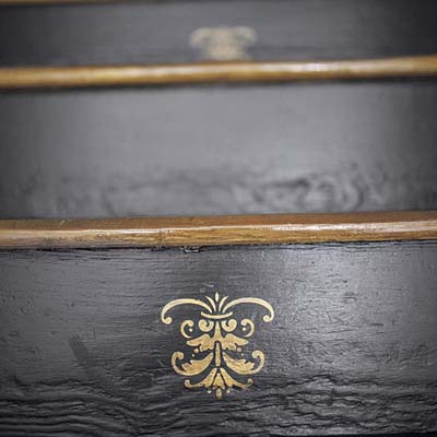 black staircase with gold stencil design