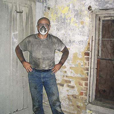 Homeowner Walt Purcell dirty from renovating house