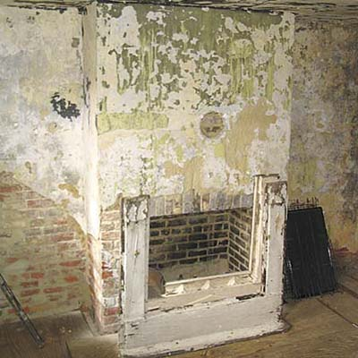 Purcell house kitchen with decrepit fireplace before remodel