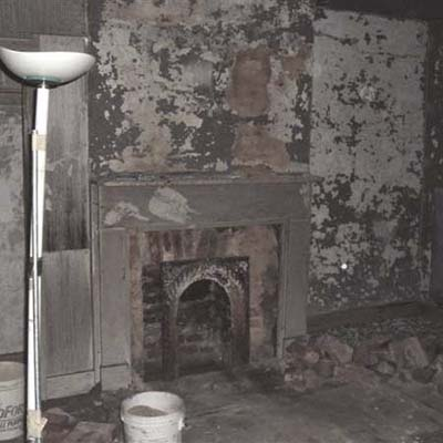 bathroom fireplace before renovation with crumbling fixtures
