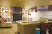 finished basement with movie screen