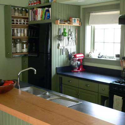 updated kitchen with green painted walls and cabinets