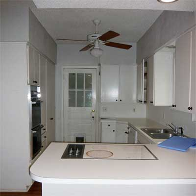 unfinished kitchen with ceiling fan