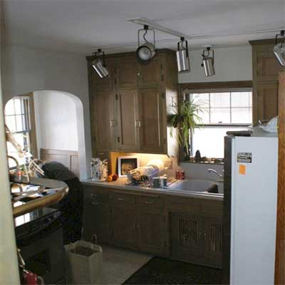 unfinished kitchen with track lighting