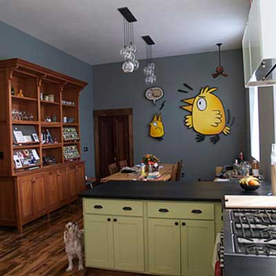 updated kitchen with painted bird motif on wall