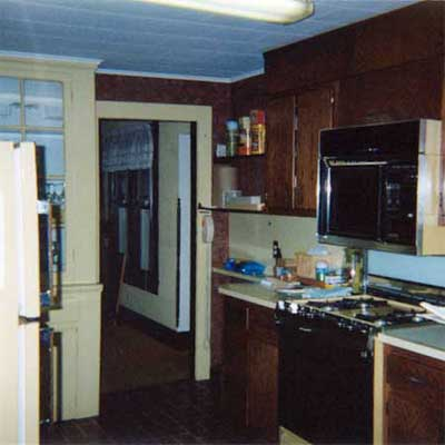 outdated kitchen with blue ceiling