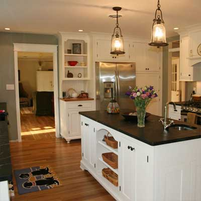 updated country kitchen with island and white cabinetry