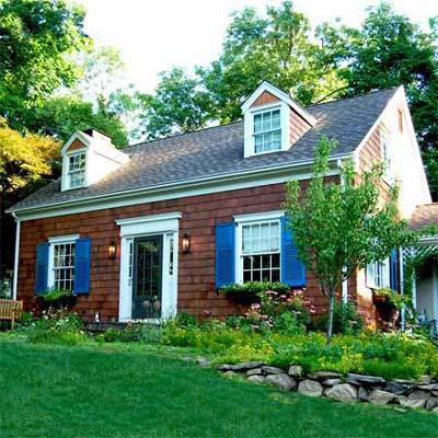remodeled home with shake shingle siding