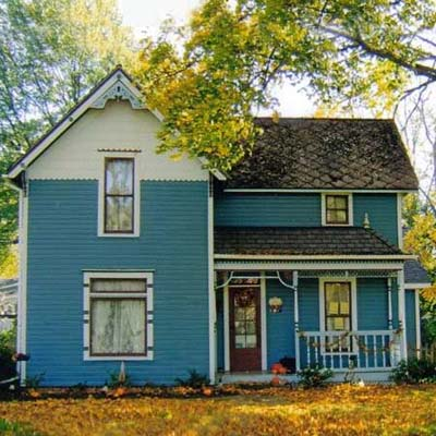 victorian house with blue siding