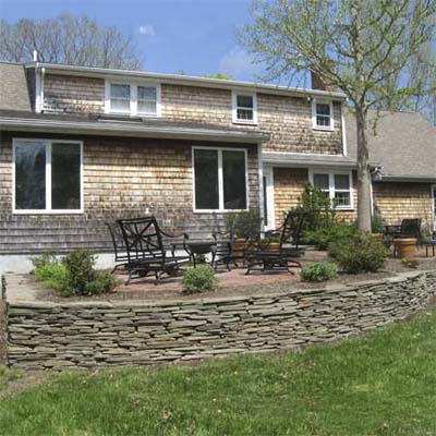 manicured backyard with stone wall