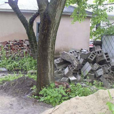 backyard with pile of cinder blocks