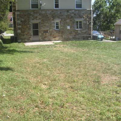 backyard with cinder block piles