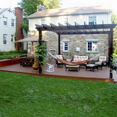 manicured back patio with brick path