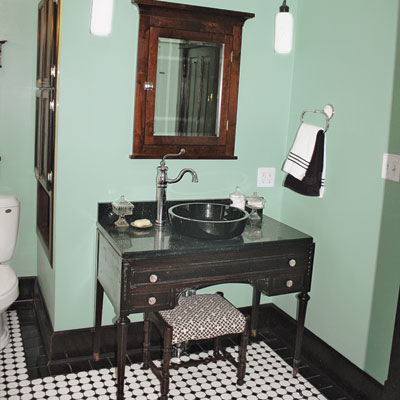 updated bathroom with vintage vanity and medicine cabinet