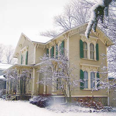 outdated victorian home in winter