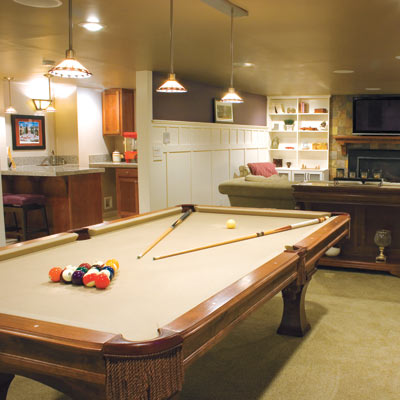 updated basement family room with pool table
