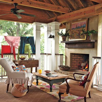 remodeled cottage with covered second story porch with fireplace