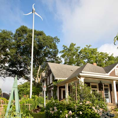 wind mill installed outside of eco friendly cottage remodel