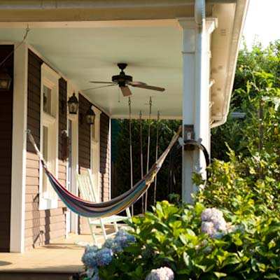 front porch with hammock and ceiling fan