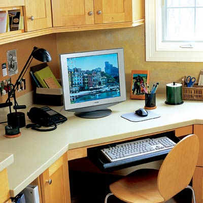 work station desk with computer in laundry room
