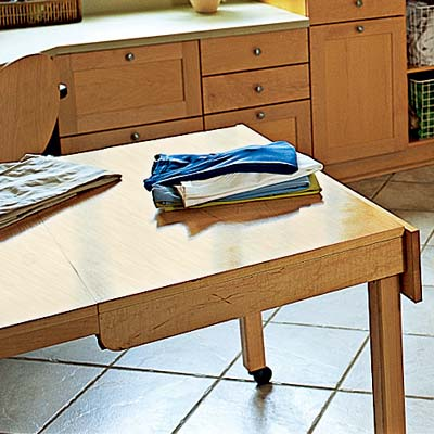 roll away craft table for folding laundry in work station laundry room