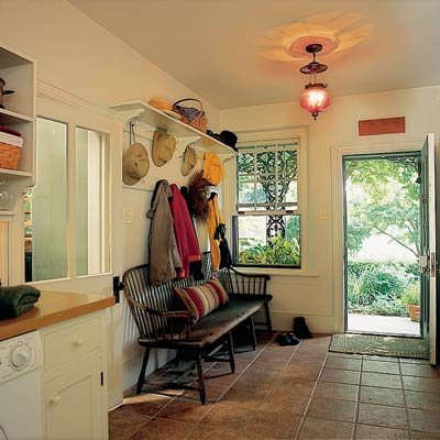 terra cotta tile floor in laundry room mud room