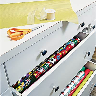 drawers containing gift wrap in family room laundry room