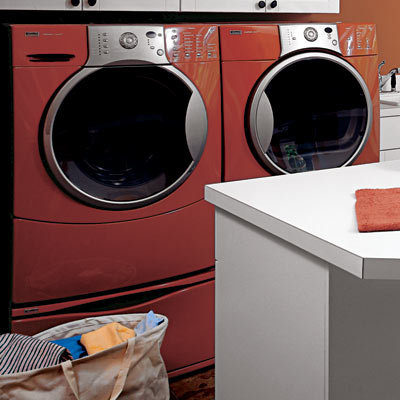 matching orange walls and washer dryer in family room laundry room