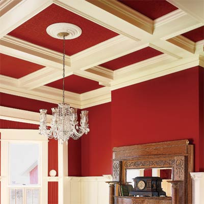 a living area that focuses on the coffered ceiling