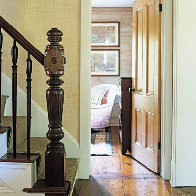 a staircase that focuses on the balustrade and newel post