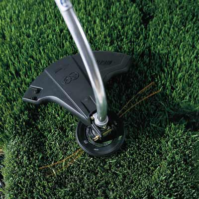 string trimmer cutting grass