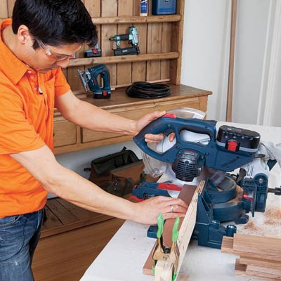man using power saw