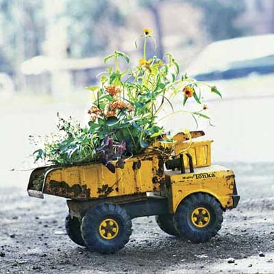 an old toy truck used as an outdoor planter