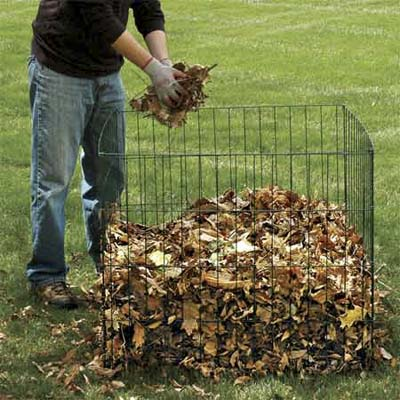 person composting yard waste
