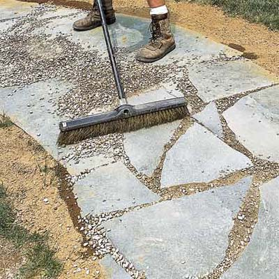 person raking gravel